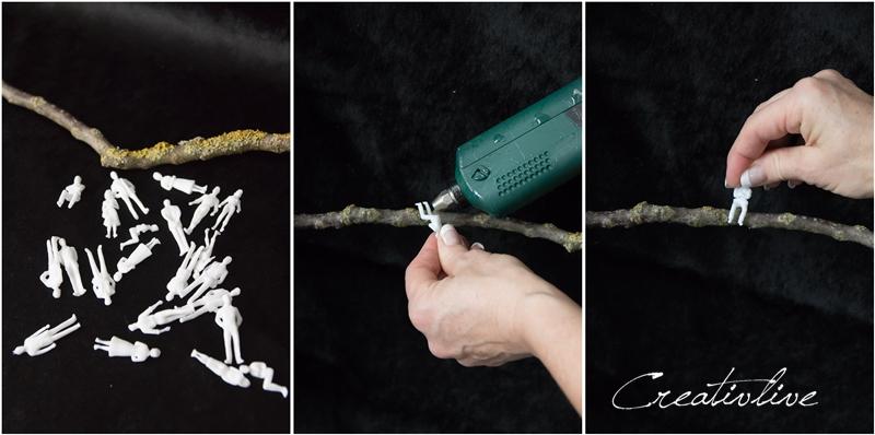 Modellfiguren an Zweig kleben